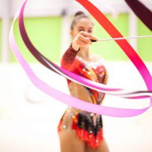 Young Rhythmic Gymnastics Athlete with Ribbon