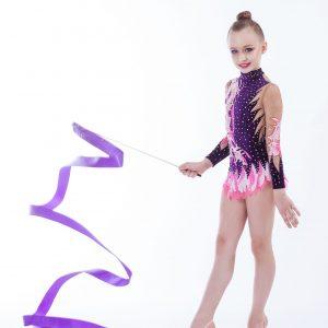 beautiful caucasian girl gymnast with Purple ribbon